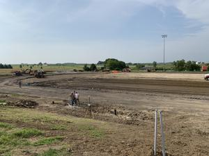 Wide Shot of Dirt football field