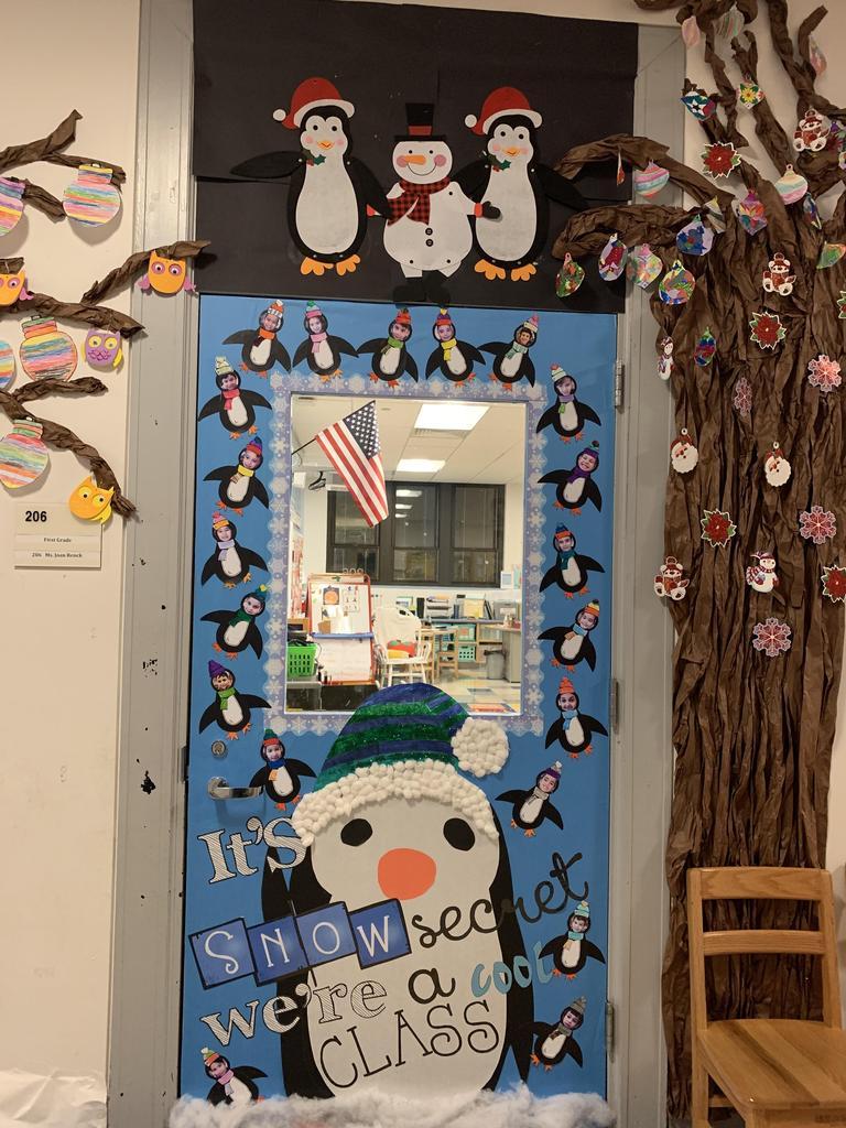 student as penguins door display
