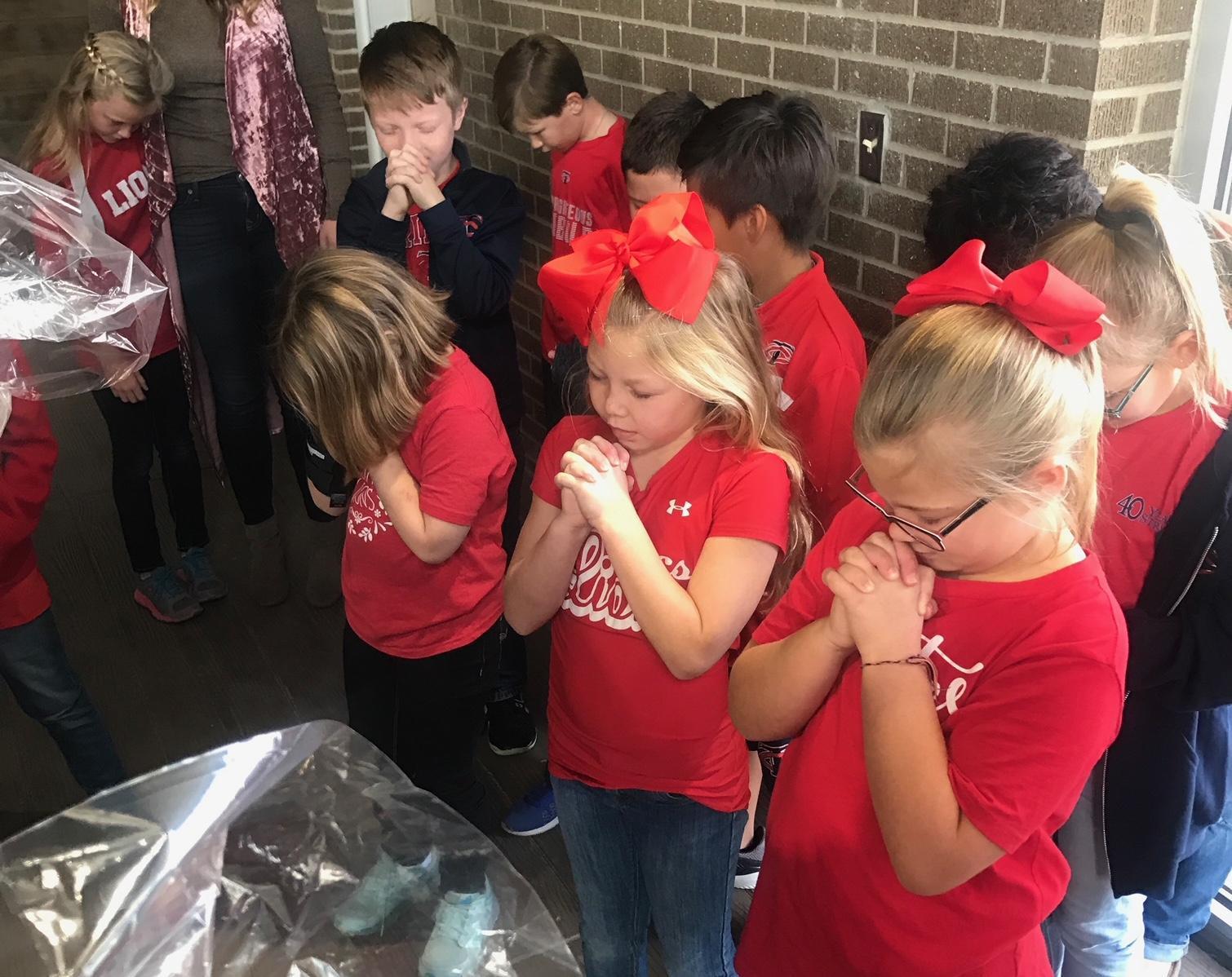 TCS students praying