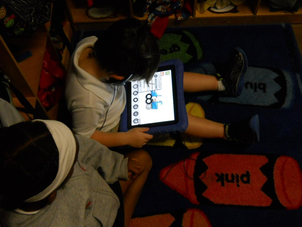 PreK working on the iPad in center time