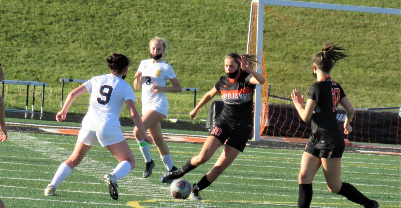 Lady Trojan soccer players in action.