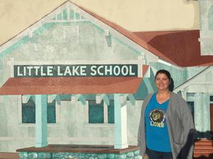 Ilene Epley in front of a Little Lake picture