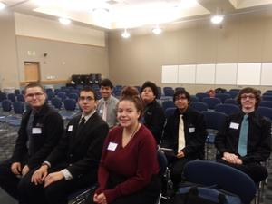 FBLA students sitting in chairs at their regional meeting.