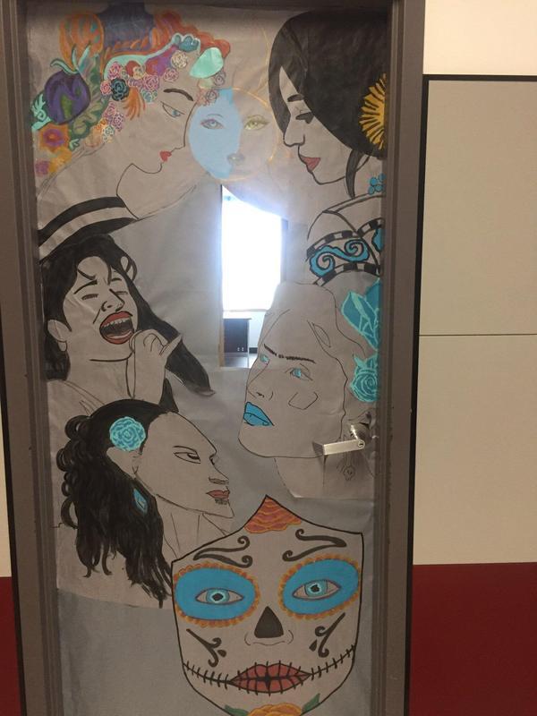 different hispanic celebrities muralized on a door.
