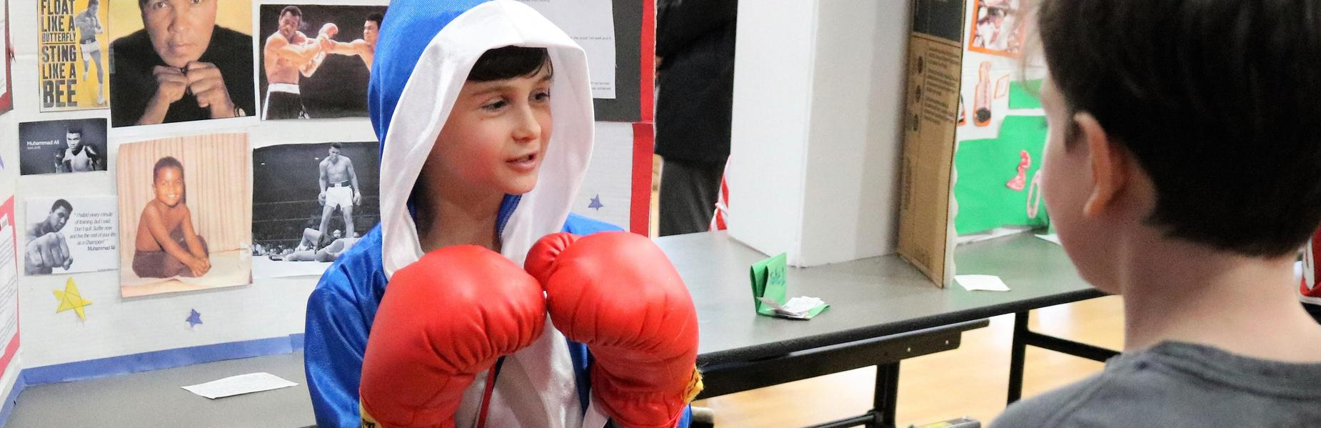 Photo of a 4th grade student dressed as Muhammad Ali during the school's