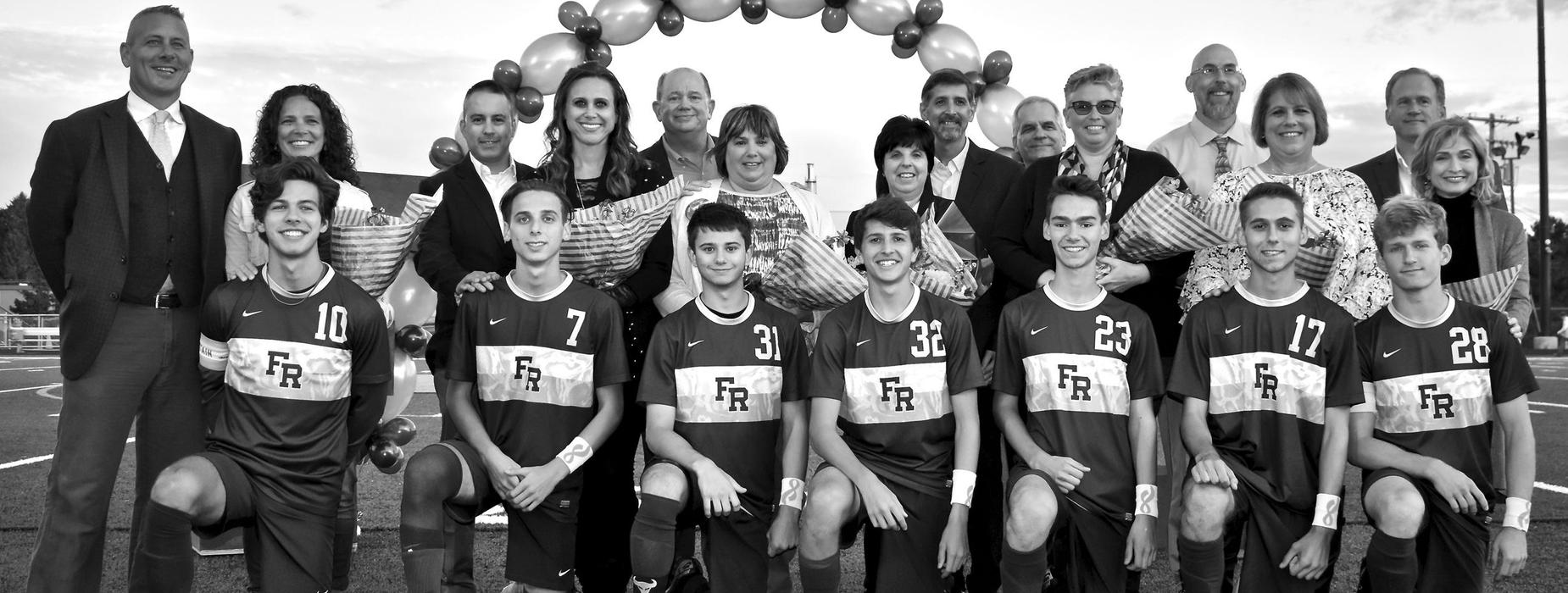 Boys Soccer team with families