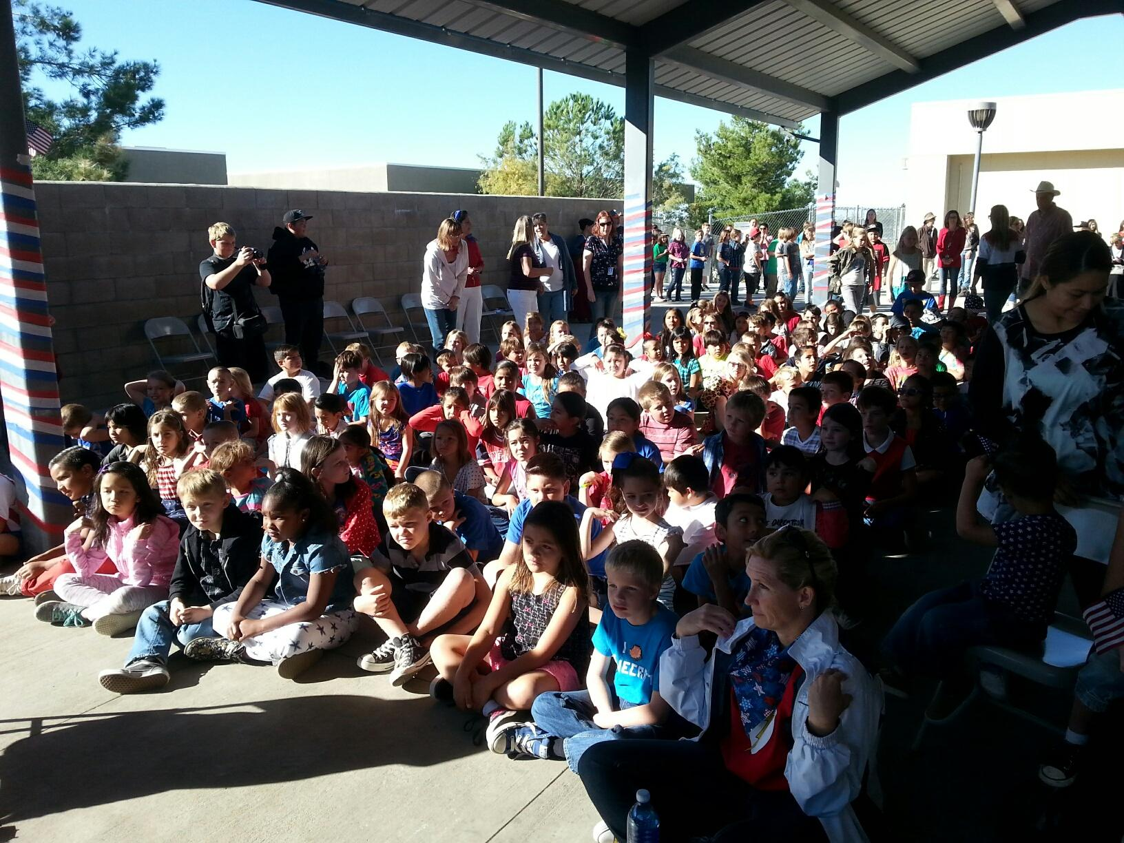 Elementary students and staff watching the performance