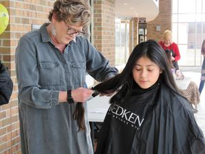 Kelly Schondelmayer of Lox Hair Salon in Middleville donated her time to help Ebbie with the project.