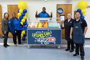 Employees Celebrating the new breakfast Cart!