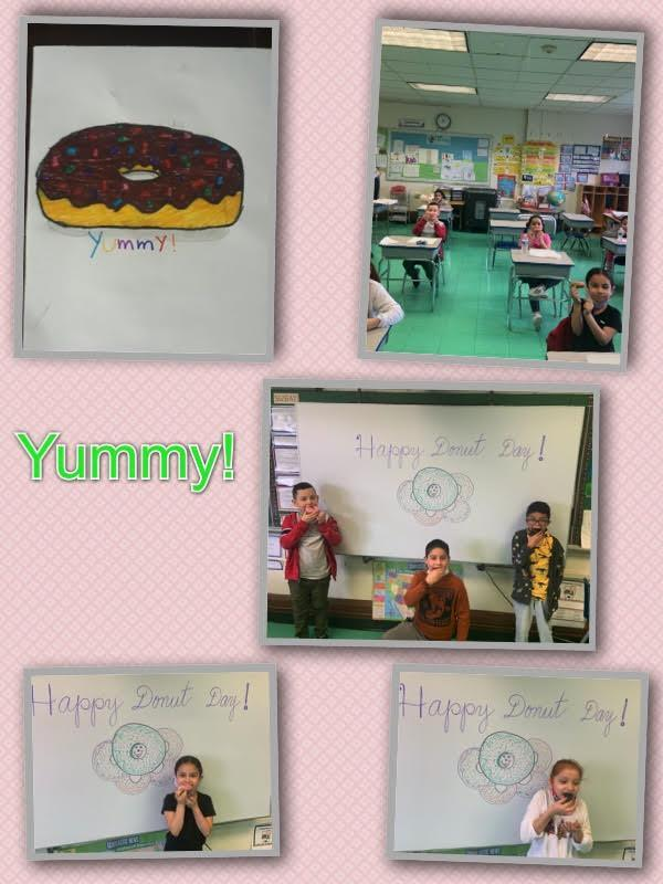 Students eating doughnuts in front of drawing on board