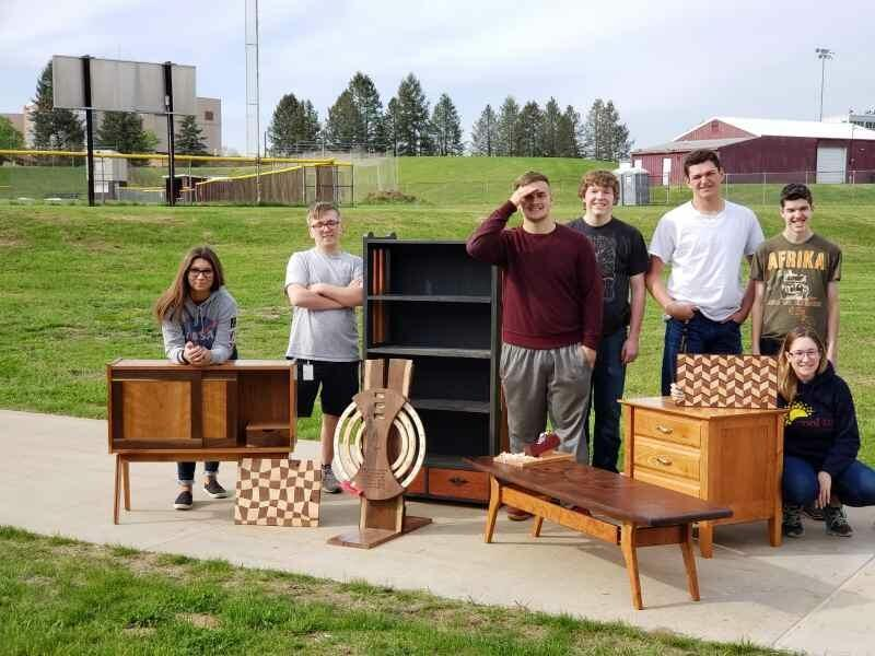 woodshop students with their projects