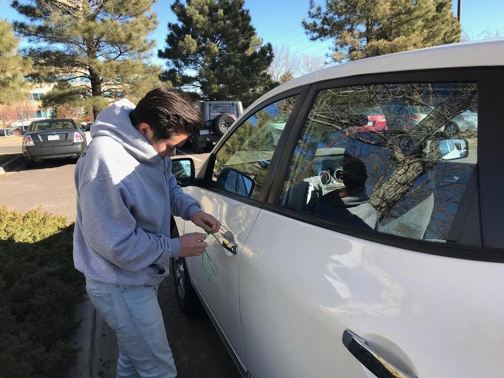 FBLA's Teen Driving Awareness Week starts with students tying ribbons on cars to bring safety awareness.