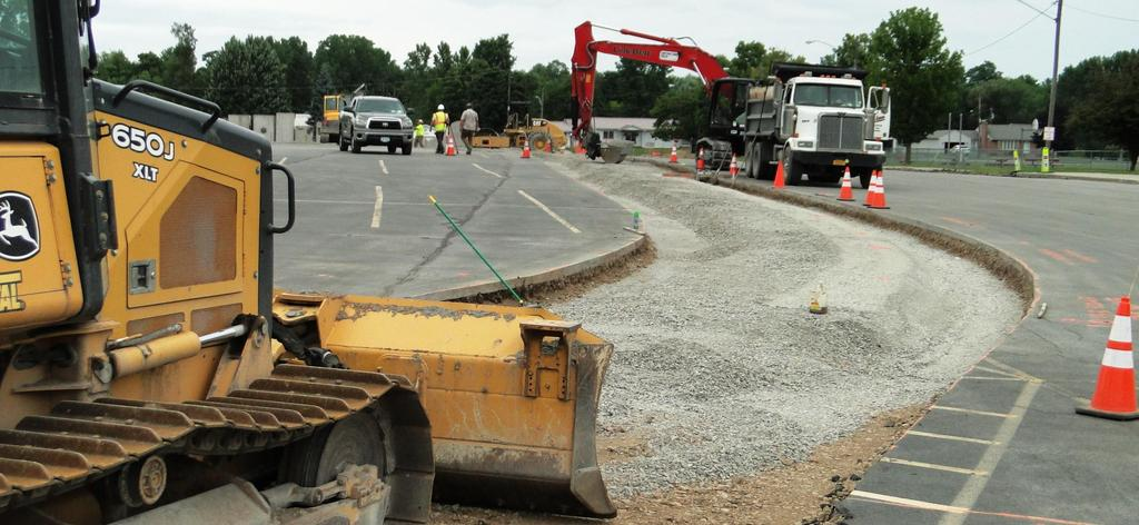 A bulldozer helps smooth the space that will be used for new sidewalks near the bus loop.
