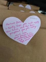 Photo of kind note written on heartshaped paper.