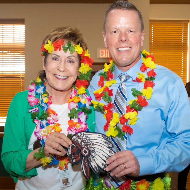 couple in hawaiian costume