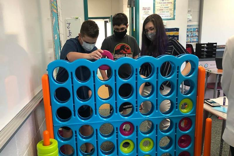 students playing Connect4