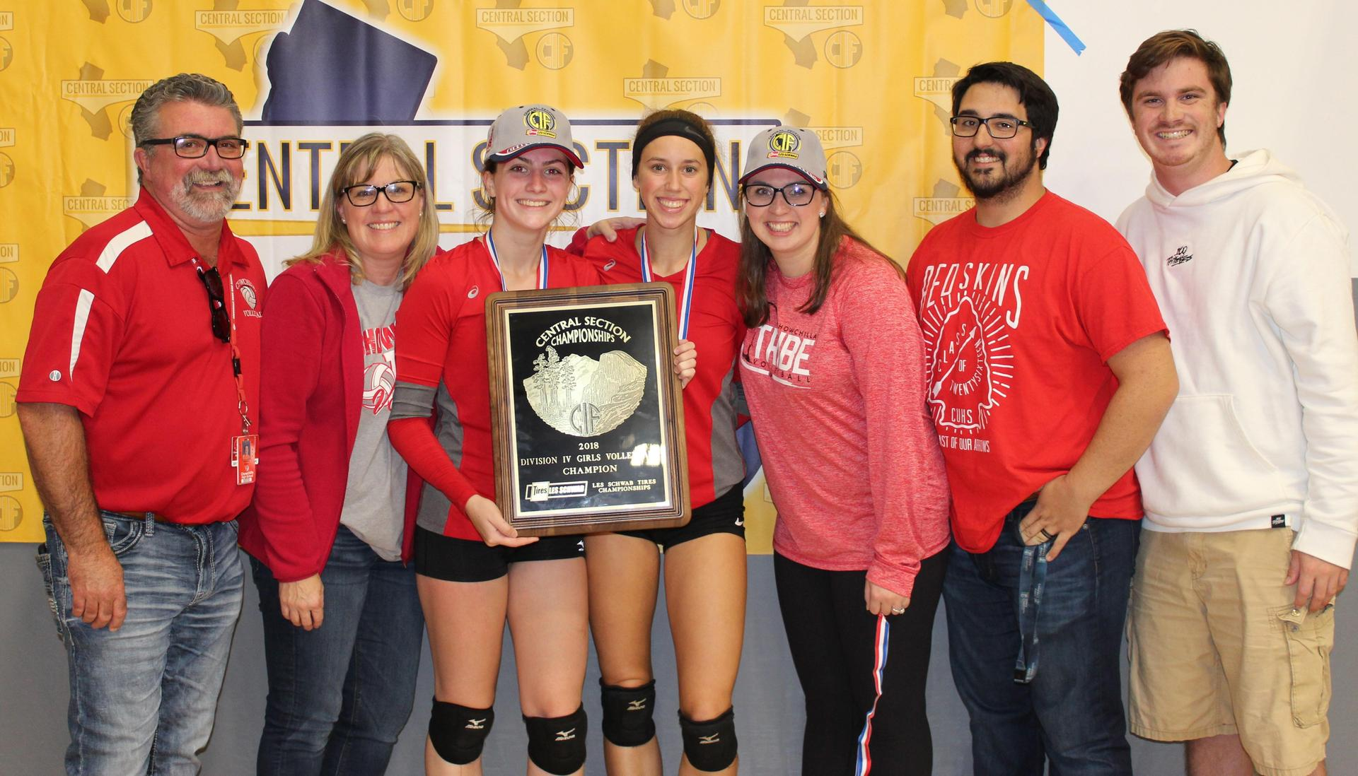 Volleyball players, parents and staff celebrating after winning