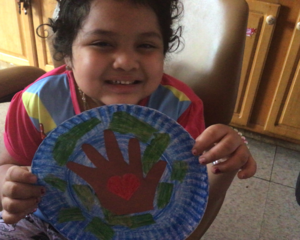 Girl holding up Earth and hand project