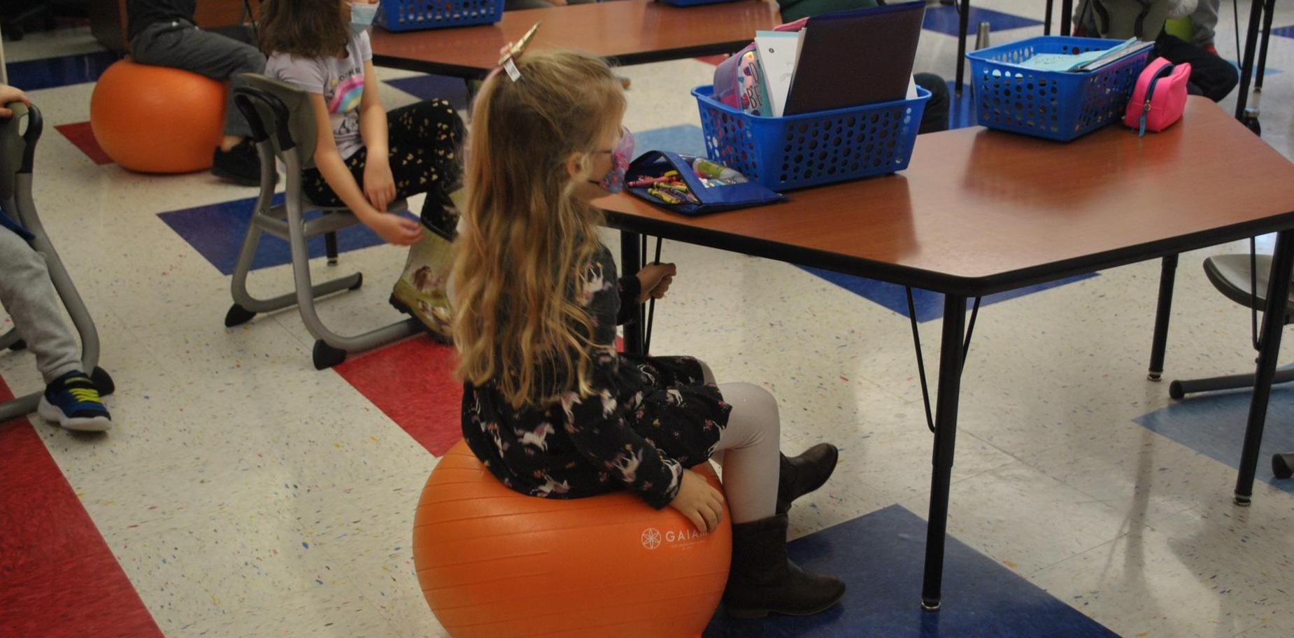 child sitting in class