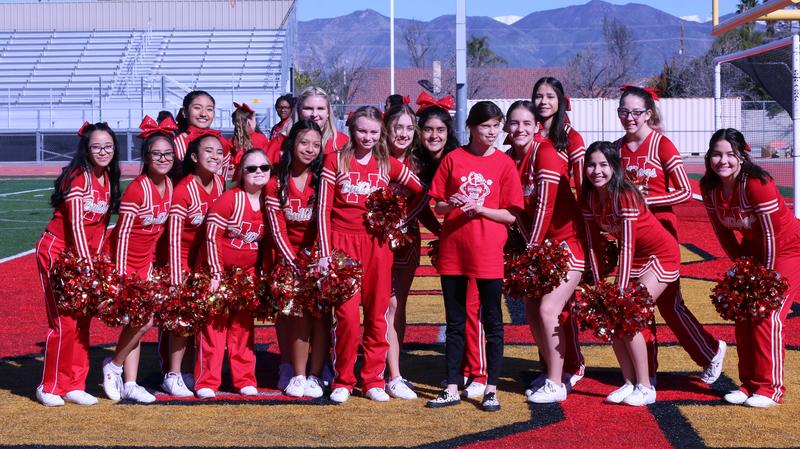 Marisa Cox enjoyed getting cheered on by the Hemet High School Cheerleaders while she made a touchdown.