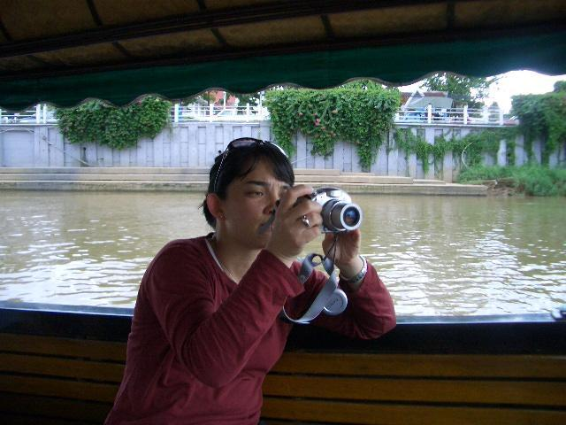 Image of Dr Lovin taking a photo from boat