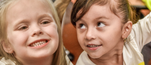Two kindergartners looking at the camera
