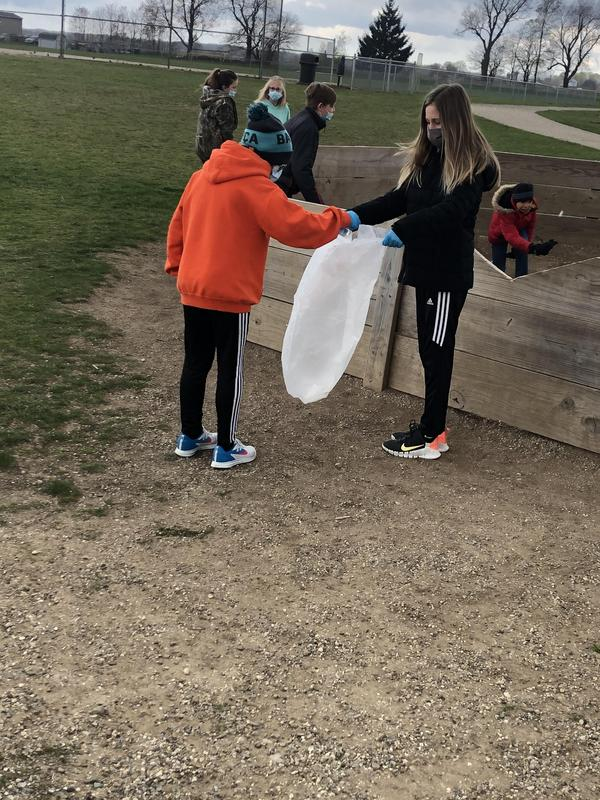 Page Student Council members cleaned up trash from the playground.