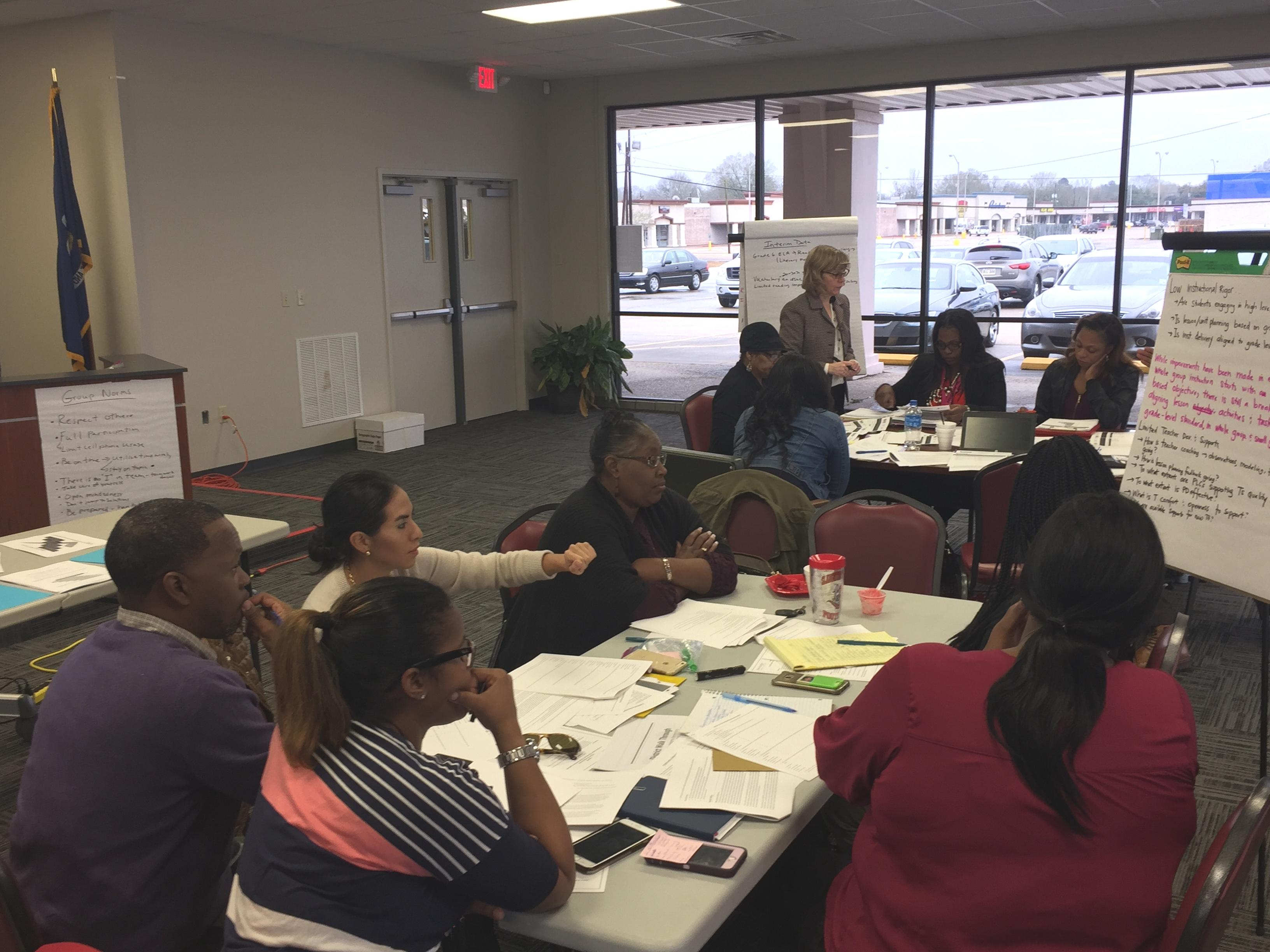 Photo of district leadership teams in collaborative planning sessions