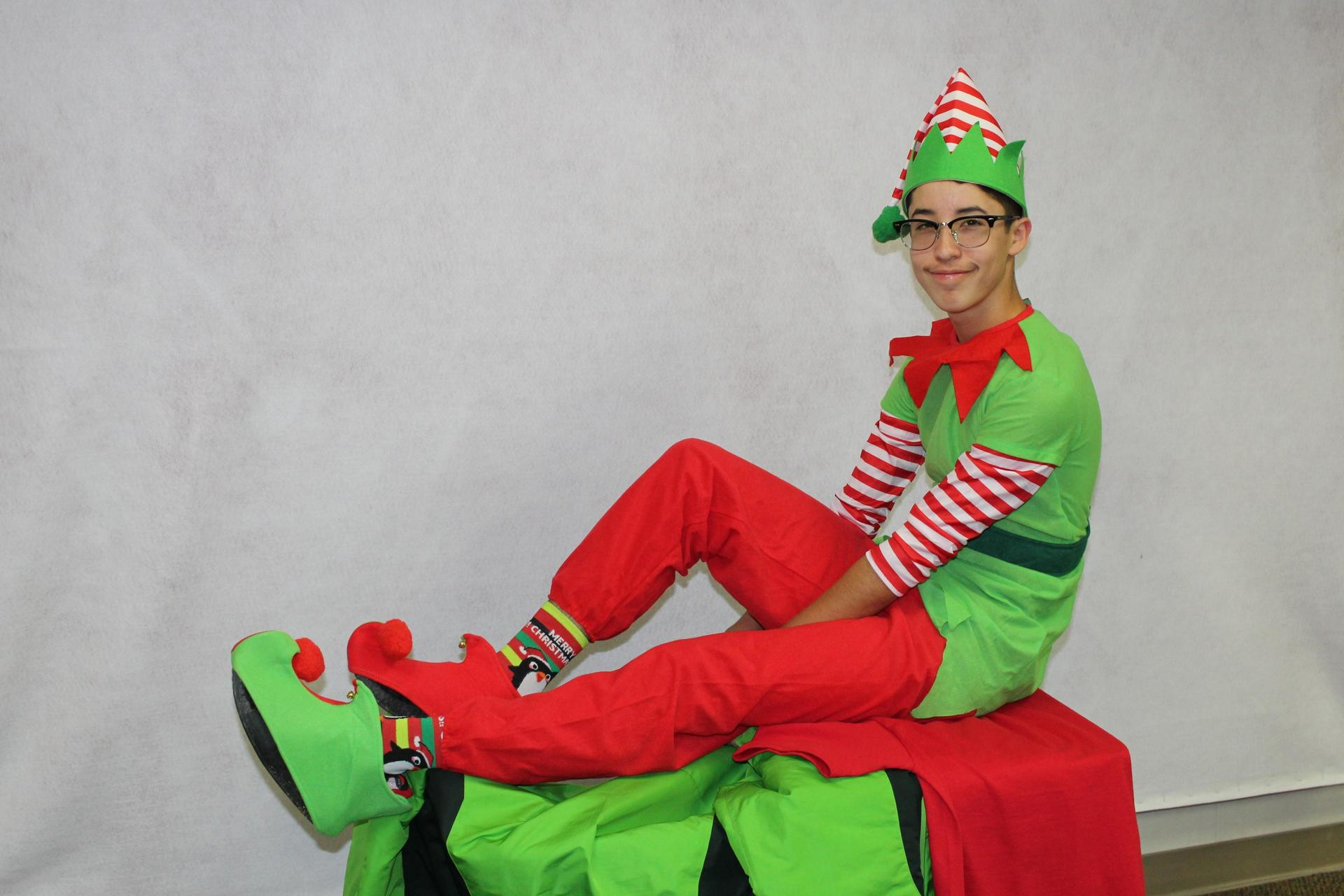 Ryan Diaz poses as one of Santa's helpers