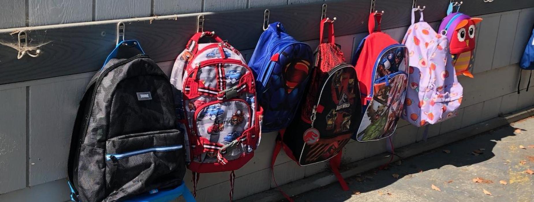 Backpacks hanged outside classroom