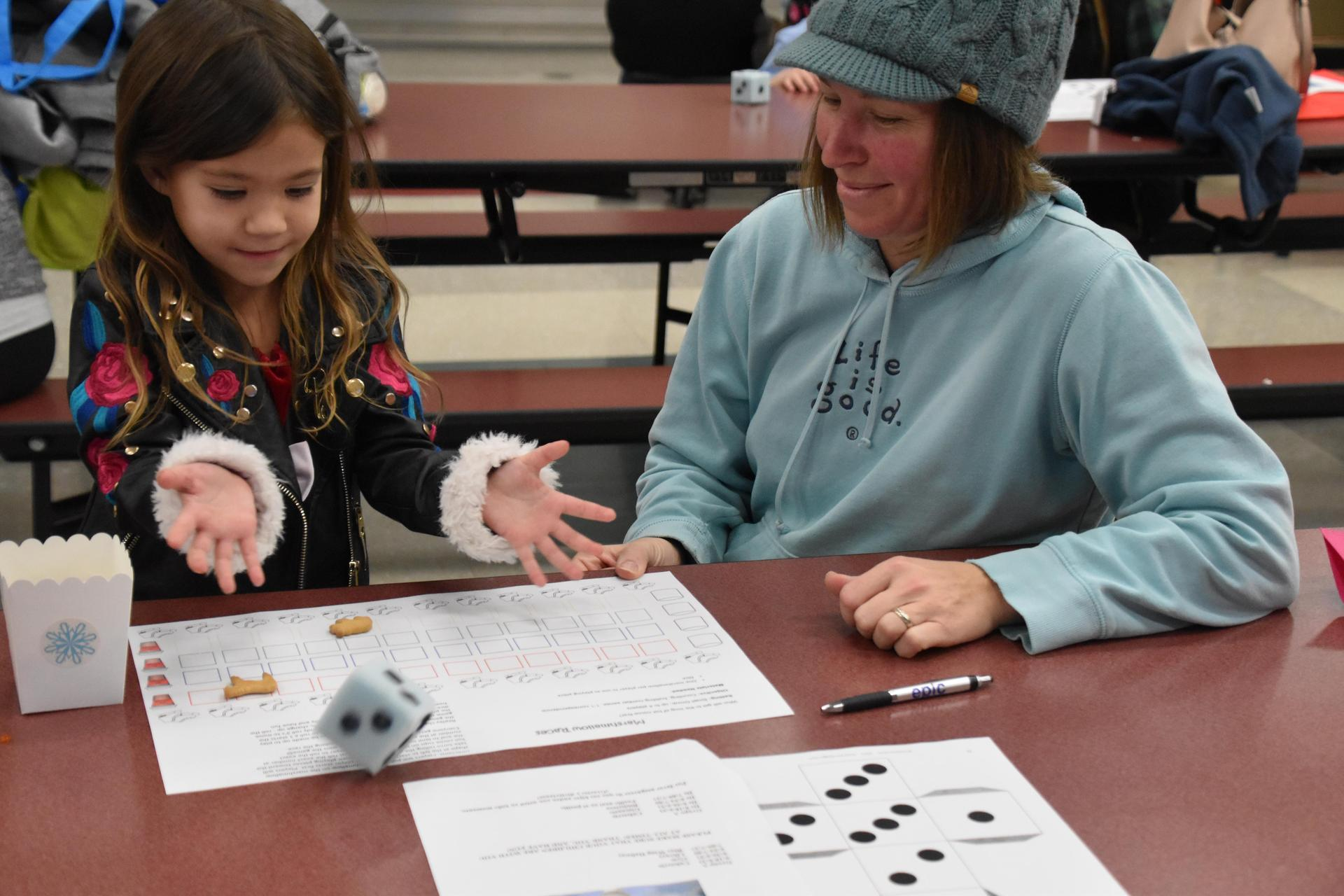 Mom and child engaging in fun math games at our PreK Family Fun Night