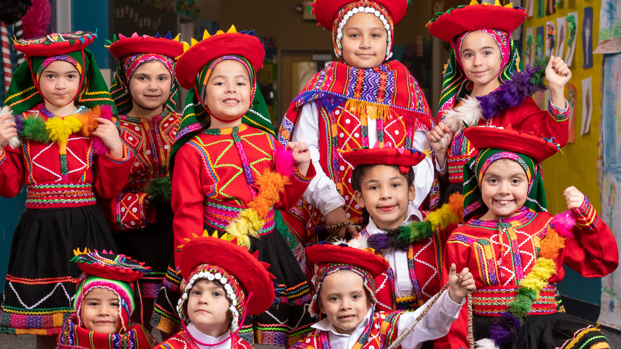 students dressed in peruvian cultrual clothes