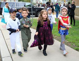 Lincoln School kindergartners show off costumes during Halloween Parade.