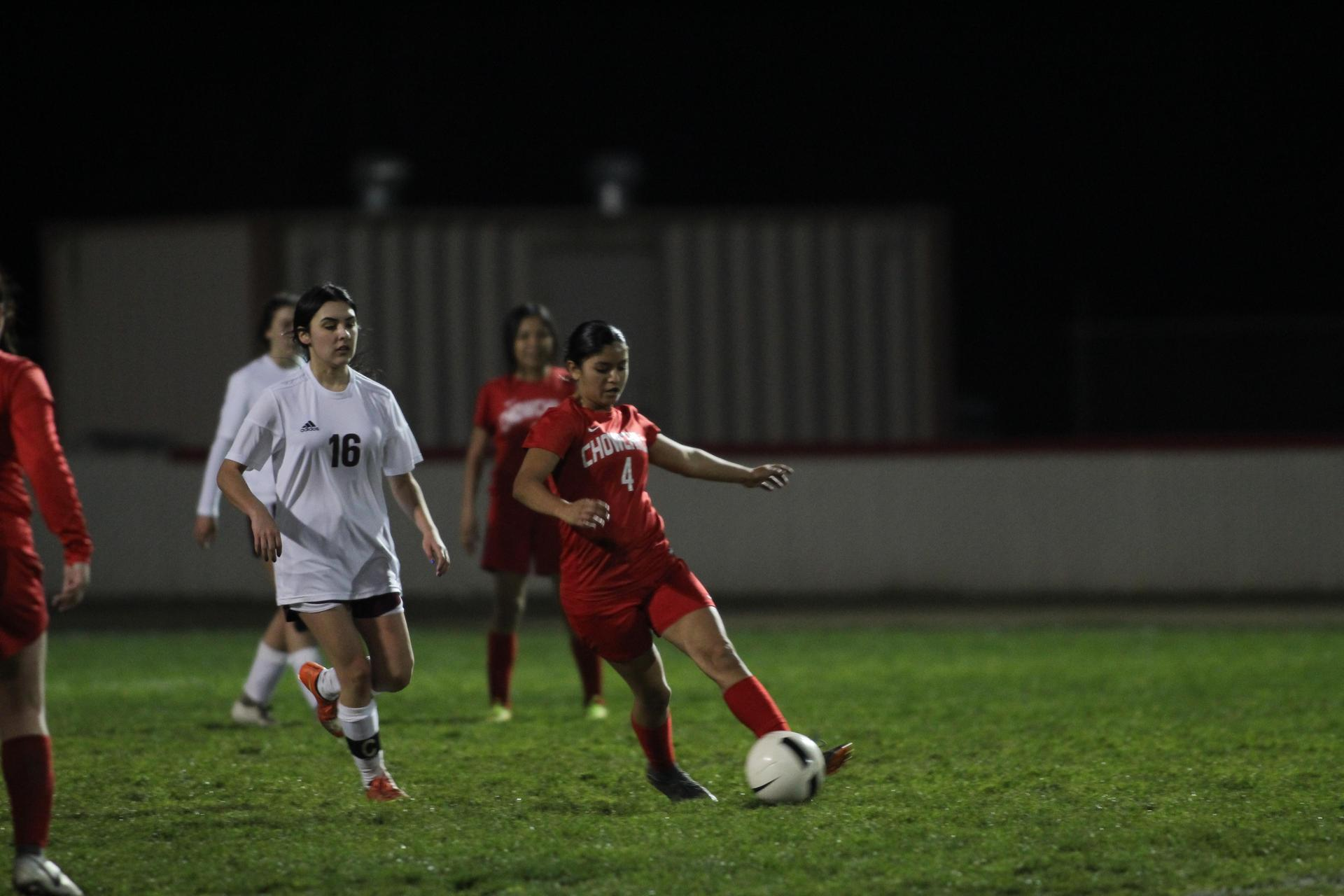 Varsity girls playing soccer against Sierra
