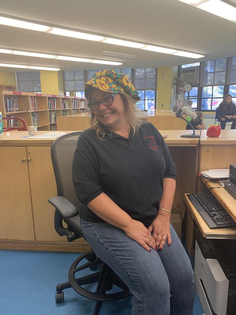 Mrs. Poser school librarian participating in Hat Day
