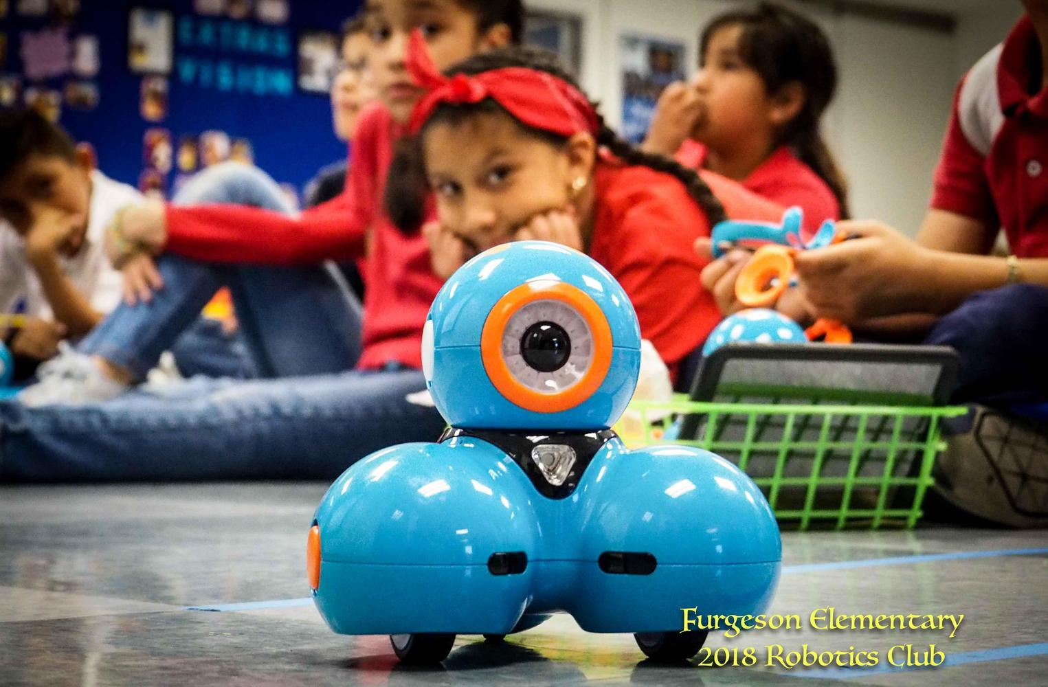 picture of robot with students in background