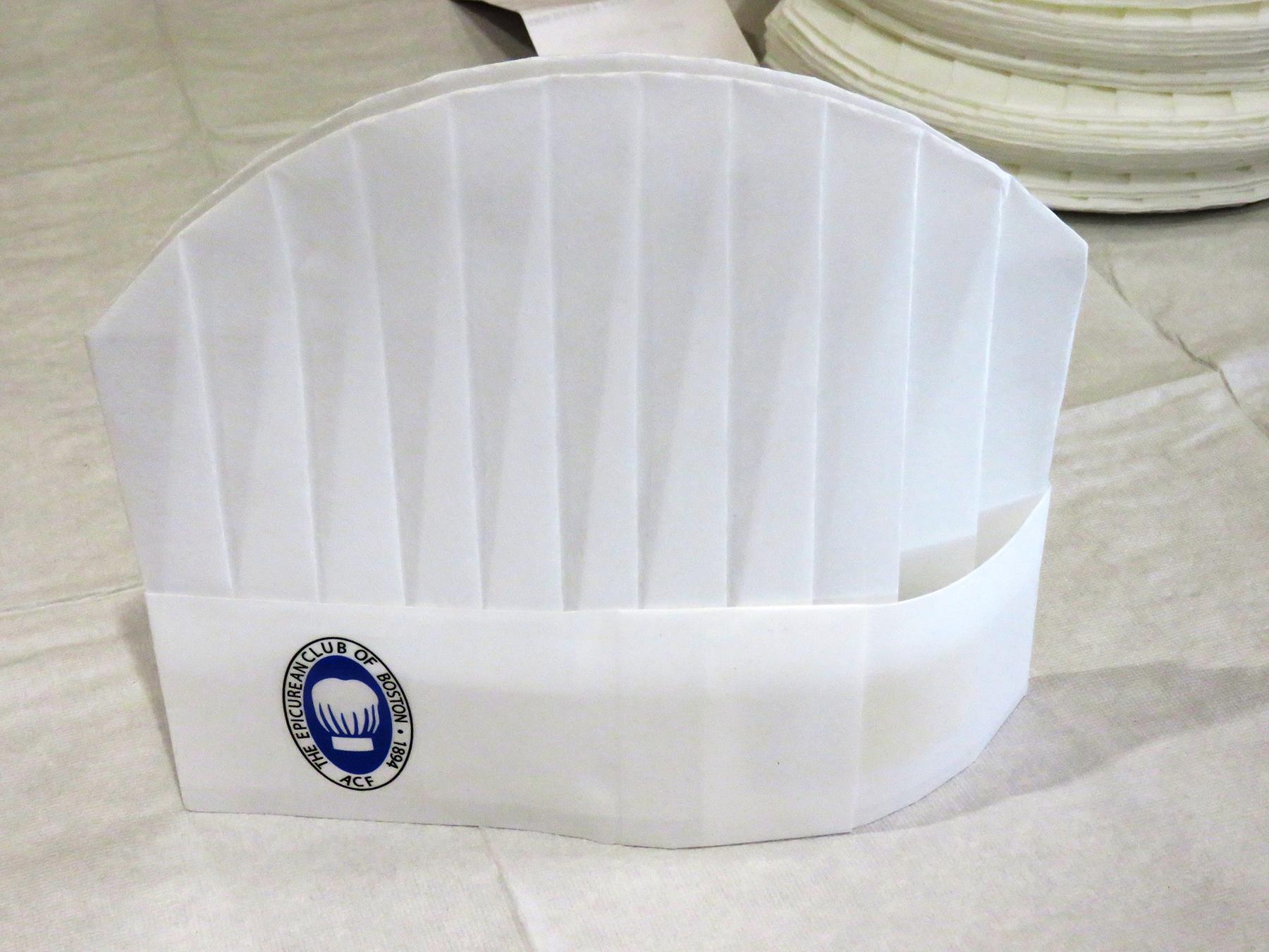 A chef's hat with the Epicurean Club of Boston logo