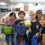 Bosall students bringing fresh garden vegetables to the lunch ladies