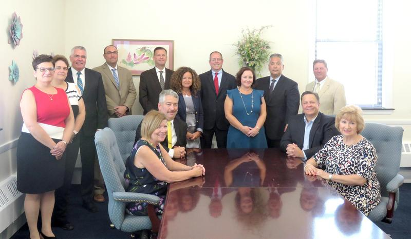EPS administrators with Exelon executive Archie Gleason