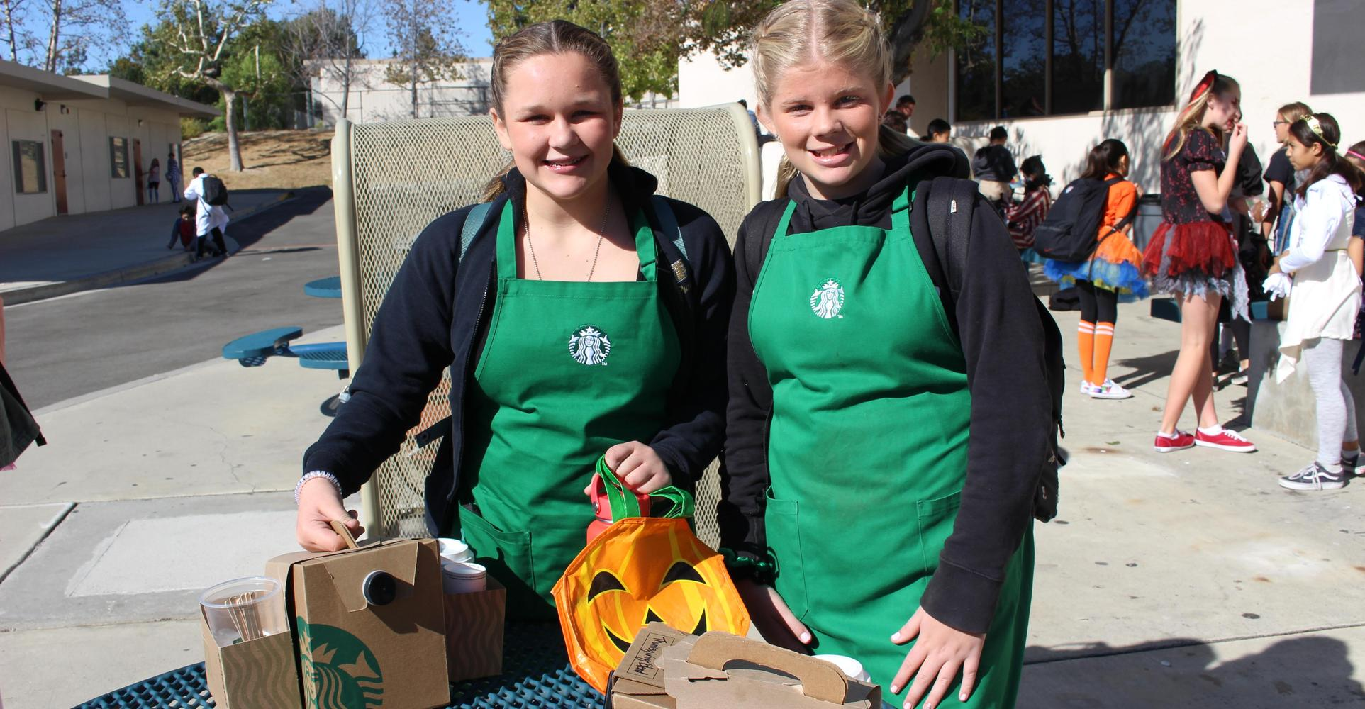 Two students dress as baristas during middle school Halloween