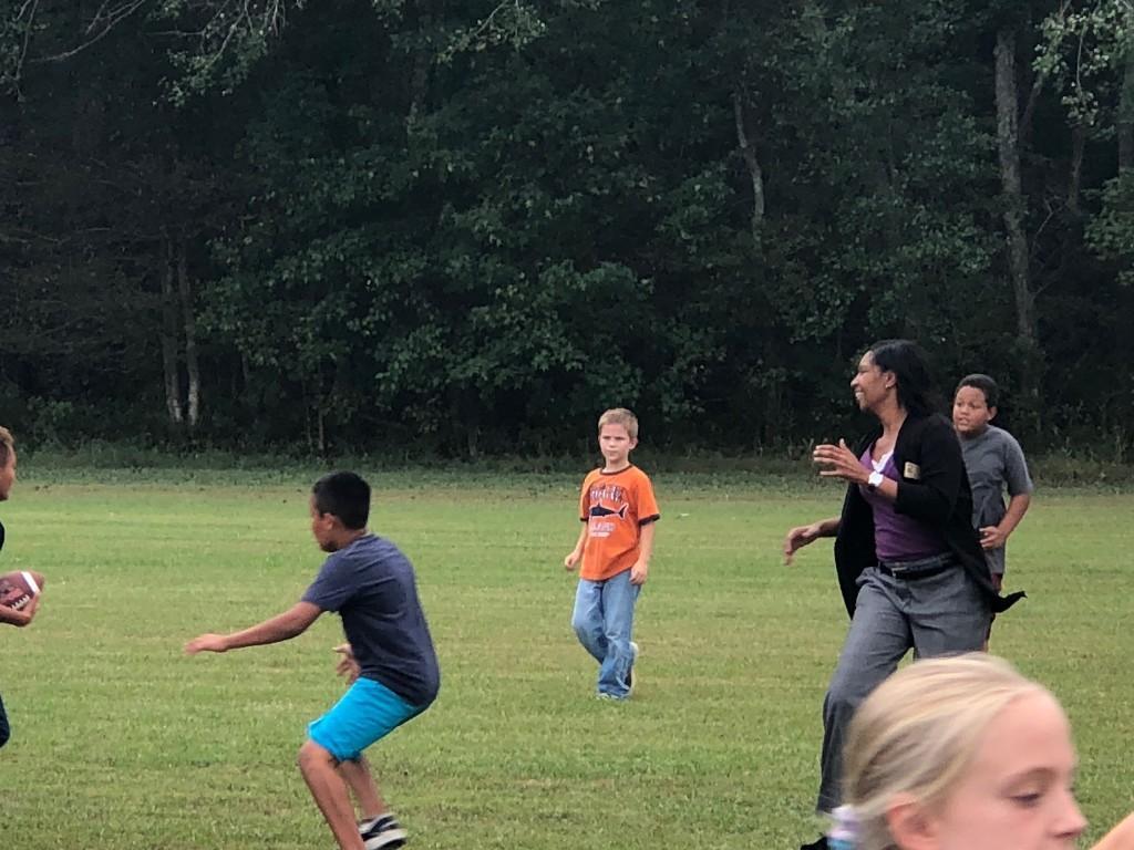 Mrs. Bennett playing football