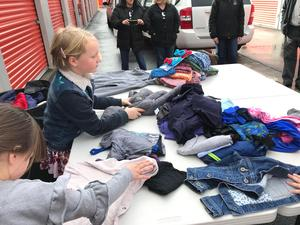 Kids collecting and sorting jackets