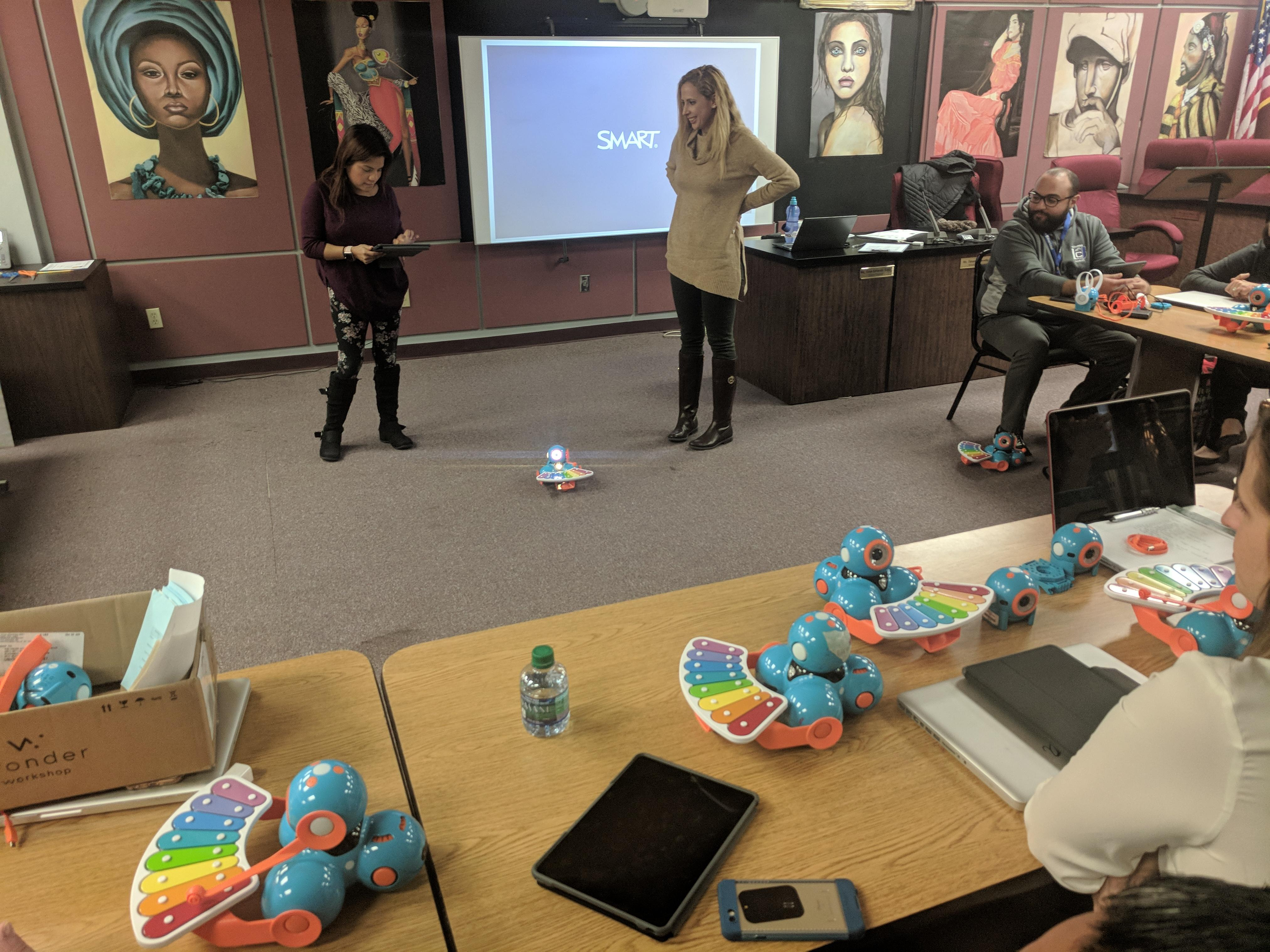 teachers working together programing dash and dot