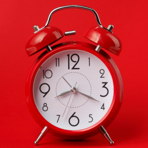 alarm clock on red background