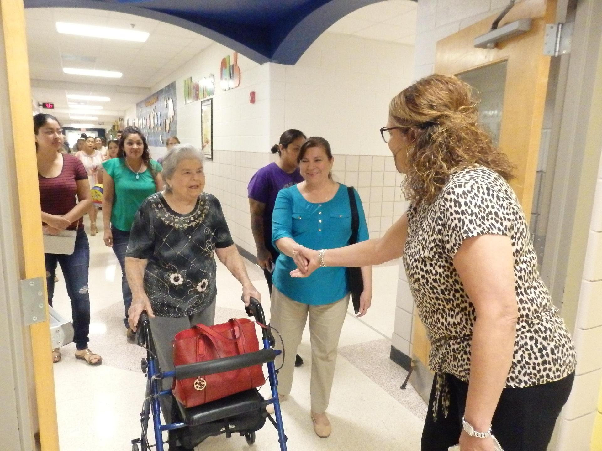 Principal greets and welcomes parents to Kinder program