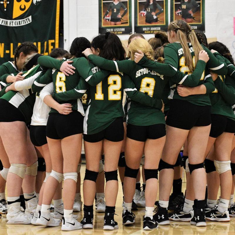 Girls Volleyball huddle