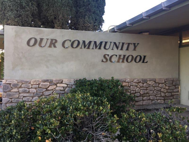 Our Community School Wall with sign