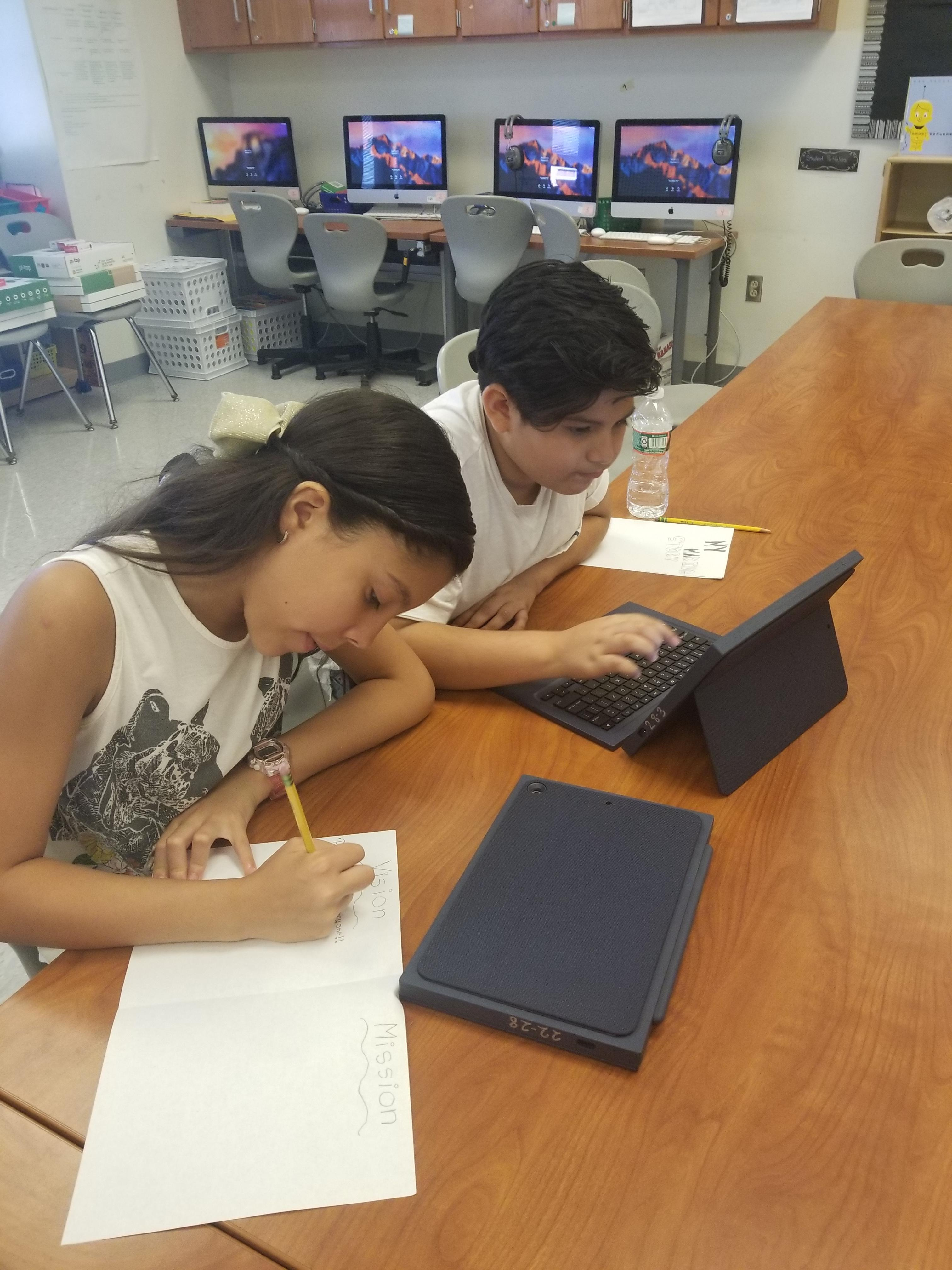 students writing in their journal