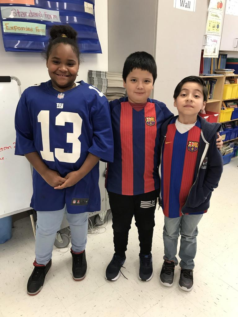 three kids wearing their jerseys