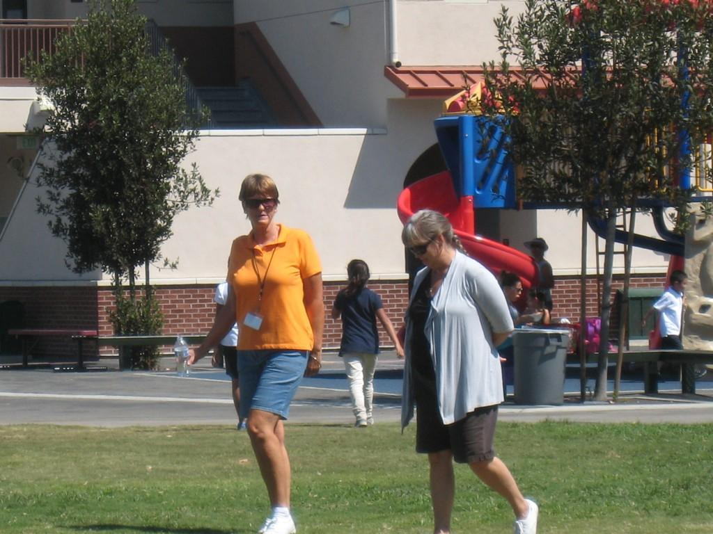 Marguerita staff walking around during the PTA/ASB Community Building Picnic